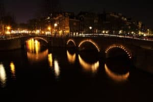 Amsterdam, cruising the canals with romantic lights from the bridges.