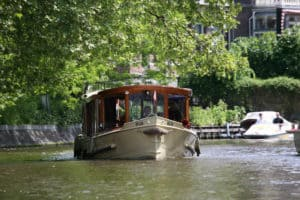 Canalboat Hilda cruising on the Amsterdam canal Singelgracht, near the Rijksmuseum