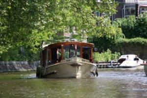 Canalboat Hilda cruising on the Amsterdam canal Singelgracht, near the Rijksmuseum
