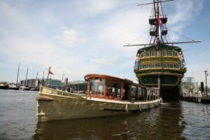 Cruising in the Amsterdam canals, behind the VOC ship called the Amsterdam of the Maritime museum